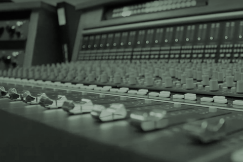 Close up image of a mixing console